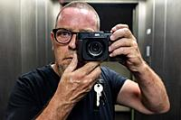 Berlin, Germany, Selfie / Self Portrait of a mature adult, caucasian man inside an elevator.