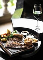 gourmet sunday roast beef traditional british meal set on old wooden pub table.