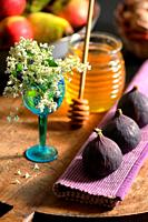 Honey, Flowers and Figs on Autumn Table.