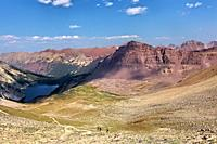 Descending to Snowmass Lake from Trailrider Pass on the Maroon Bells Loop, Aspen, Colorado, USA.