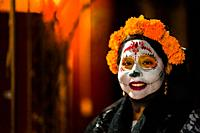 A young Mexican woman, dressed as La Catrina, a Mexican pop culture icon representing the Death, takes part in the Day of the Dead celebrations in Oax...