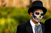 A Mexican boy, dressed as La Catrina, a Mexican pop culture icon representing the Death, takes part in the Day of the Dead celebrations in Oaxaca, Mex...