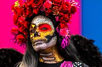 A young Mexican woman, dressed as La Catrina, a Mexican pop culture icon representing the Death, takes part in the Day of the Dead festivities in Oaxa...
