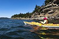 Woman, 70, kayaking off Saturna Island, BC, Canada.