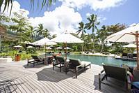 Pool area on the beach in Constance Ephelia Resort on the west coast of Mahé island, Seychelles.