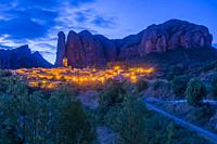 Landscape of the Mallos de Aguero by night famous geological formations with the town of Aguero in the province of Huesca Aragon, Spain.