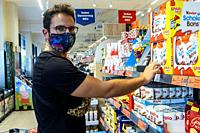 Berlin, Germany. Mature gay male shopping for groceries inside a local supermarket wearing a ´protective´ facemask due to Corona Outbreak and Covid-19...