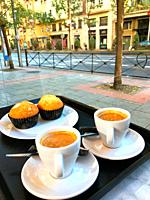 Two cups of coffee with muffins in a cafeteria. Madrid, Spain.