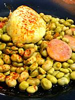 Broad beans with egg and butifarra. Spain.