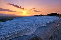 Empty travertine pools at sunset in Pamukkale.