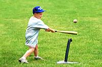 4 and 5 year old boys and girls learn how to hit a ball off of a tee.