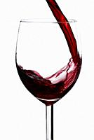 wineglass with red wine isolated on white background.
