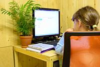 A student learns lessons in a computer with online distance learning.