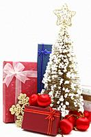 red holiday gift box with christmas tree and ornament.