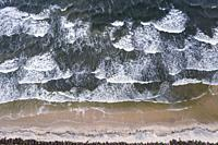 Waves on a beach of Vistula Spit, stretch of land separates Gdansk Bay int he Baltic Sea and Vistula Lagoon in Poland.