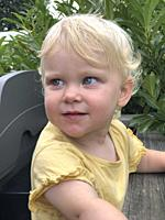 Blond little girl, two years old, looking aside in Scania, Sweden, Scandinavia.