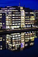 Stockholm, Sweden An office building at nighjt neighborhood of Liljeholmskajen and Marievik.