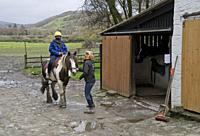 Customers riding on horses at the Rheidol riding centre in Capel Bangor in Ceredigion,Wales,UK.