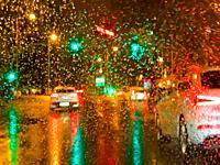 Urban traffic in a rainy night.