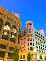 Facade of buildings, night view. Gran Via street, Madrid, Spain.