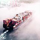Barge loaded with containers heads to a port in the Atlantic Ocean, Canada.