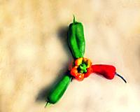 World's hottest peppers arranged in a fan design on a granite counter.