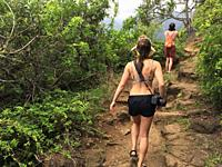 Hikers on a hot summer day, Kalalau Trail,Kauai, USA.