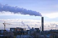 The chimney with smoke from the district heating plant in Uppsala, Sweden.