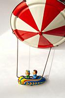 Flying chairs tin toy.