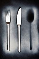 cutlery, spoon, fork, knife on black background.