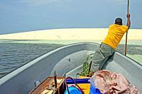 white sand dune and boatman, Unguja island, Kizimkazi, Zanzibar