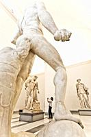 The Farnese Hercules, c. 216 AD (4th century BC for original) at the background, marble statue, National Archaeological Museum of Naples, MANN, Naples...