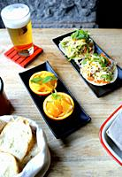 Mexican tortillas and orange with beer in a restaurant