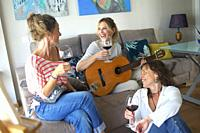 Playing the guitar and toasting at a friends meeting