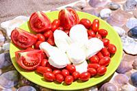 italian healthy food: mozzarella tomatoes bread oil and oregano.