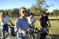Group of friends enjoying an afternoon on bicycles in the park....
