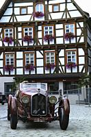 veteran, vintage cars, automobiles in the streets of Messkirch, historic center.