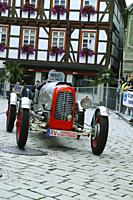 old single seater racing car on cobblestone street in historic city center of Messkirch.