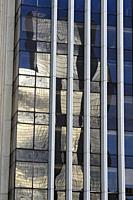 Tower reflect in La Defense district in the westernmost part of Paris, France.