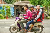 three on a motor scooter, Satun Province, Thailand.
