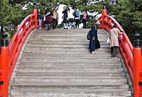 Tourists crossing taiko bashi bridge at Sumiyoshi-taisha shrine, Osaka, Japan
