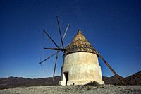 Windmill at night in San Jose, Cabo de Gata natural park, Almeria, Spain