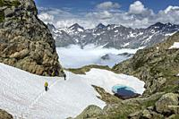 Two people hiking at Col de Peyreget, Pyrenees national park, France