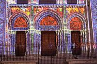 Illuminated cathedral , portals.