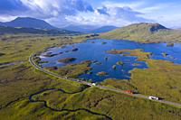 Aerial view of Lochan na h-Achlaise and A82 road crossing Rannoch Moor in summer, Scotland, UK.