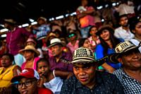 Colombian peasants, sitting on the bleachers, watch an amateur bullfight in the arena of Corralejas, a rural bullfighting festival held in Soplaviento...