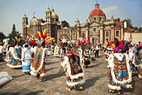 Indigenous dancers in traditional costumes during the Virgen de Guadalupe Festival near Basilica Guadalupe in Mexico City, Mexico, Central America.