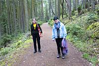 Two women hiking at Edith Point on Mayne Island, BC, Canada.