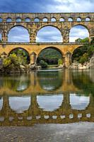 Pont du Gard, Languedoc Roussillon region, France, Unesco World Heritage Site. Roman Aqueduct crosses the River Gardon near Vers-Pon-du-Gard Languedoc...