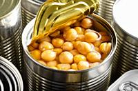 Canned chickpeas in just opened tin can. Non-perishable food.